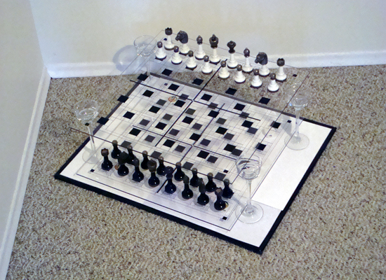 White gets to choose to be on the bottom or top board. Black is on the other board level.